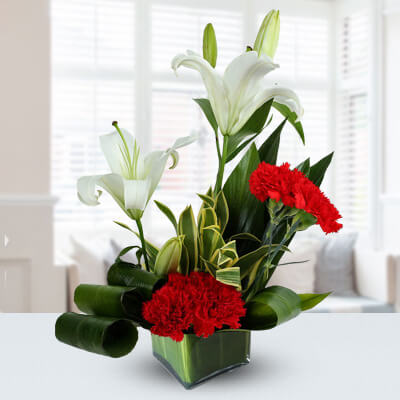 Cube Vase with lilies and Carntions