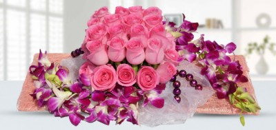 Roses and orchid arrangement